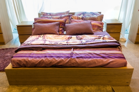 bedsheets: a cozy and luxurious bed in a home bedroom