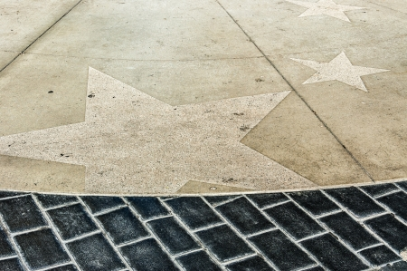 the paving of a walkway in hollywood with stars engraved in the tiles Stock Photo - 20426699