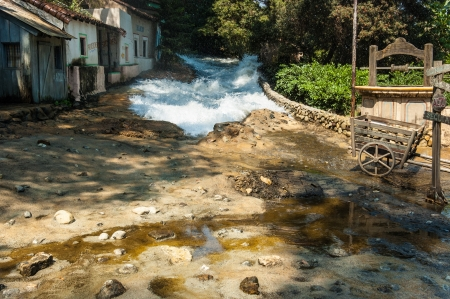 a flooding, maybe the consequence of torrential rains, occurring in a small village