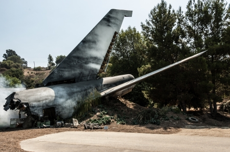 an airplane tail in a plane crash site Stock Photo