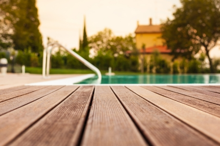 pool deck: the planking of a swimming pool with shallow depth of field Stock Photo