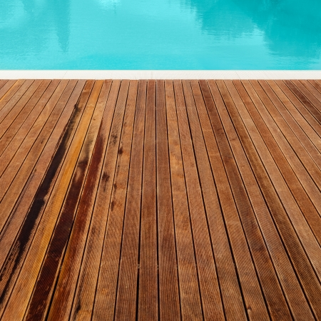 wood flooring: the planking of a swimming pool and its edge