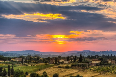 a majestic sunset in a rural zone of tuscany with vibrant colors photo