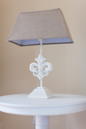 a bed side table with a classical style bed lamp on it Stock Photo - 20435638