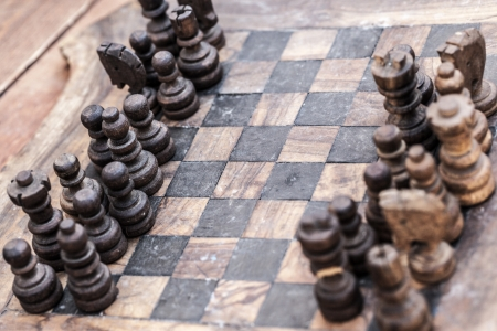 medieval chess set made of wood, with stains and scratches photo