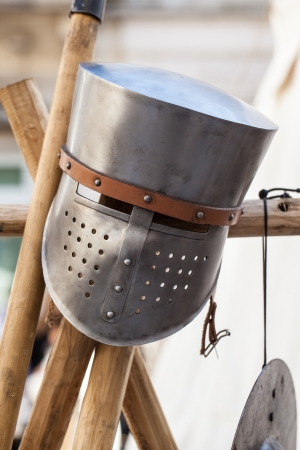 a medieval knights helmet on a wooden pole photo