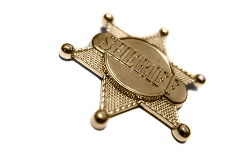 a wild west sheriff's star isolated on a white background photo