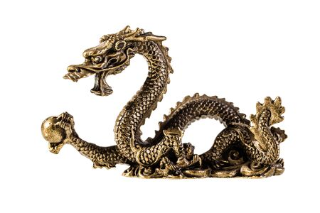 an ancient metallic golden dragon isolated over a white background Stock Photo - 20563662