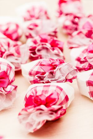 a lot of pink wedding gift arranged on a table photo