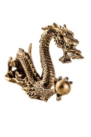 an ancient metallic golden dragon isolated over a white background Stock Photo - 20563560