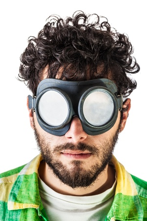 a guy wearing casual clothes and on old pair of goggles over a white bachground Stock Photo