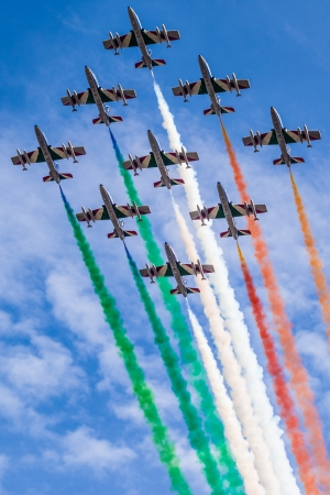 The italian acrobatic jet squad named frecce tricolori doing tricks in the sky photo