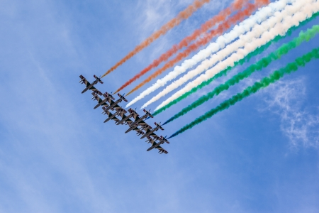 The italian acrobatic jet squad named frecce tricolori doing tricks in the sky Stock Photo