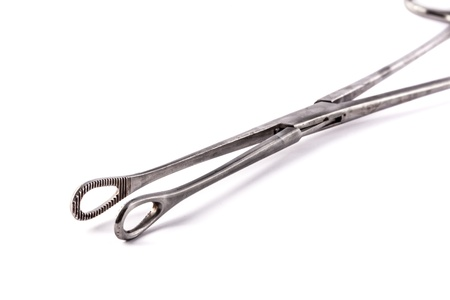 a pair of stainless steel surgical forceps over a white background photo