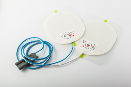 a pair of automatic defibrillator patches on a white table Stock Photo
