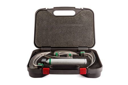 over packed: a laryngoscope with different heads isolated over a white background and packed in a case