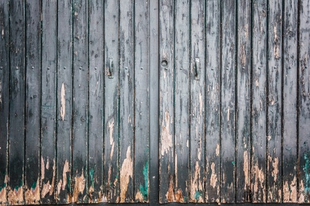 an old wooden and grungy locked door typical of the south of italy photo
