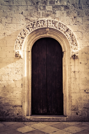 a beautiful wooden portal of a church in south italy Stock Photo