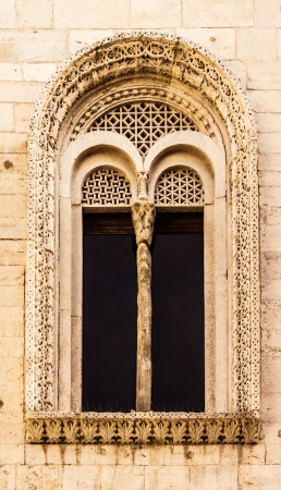 ecclesiastical: an antique window with a lot of complex carvings and friezes Stock Photo