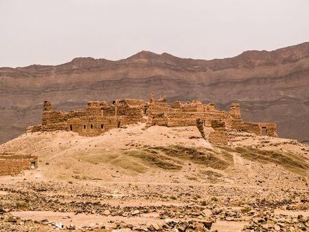Ancient moroccan Kasbah ruins located in the Draa Valley Stock Photo - 20564225