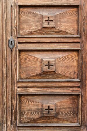 detail of an elegant and luxurious old wooden door photo