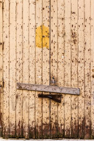 boarded: a rusty, abandoned and boarded up old door