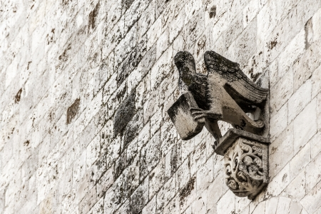 an ancient sculpture on the facade of a church in italy photo