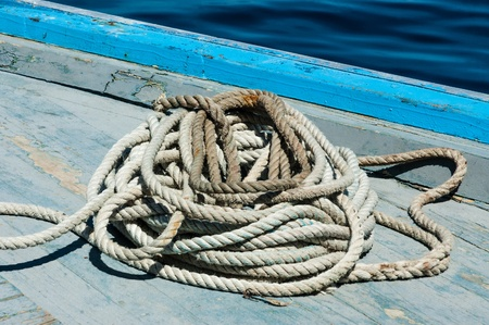 coiled rope: a nautical rope on the bridge af a touristical boat in Maldives