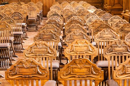 a lot of luxuus and expensive royal chairs arranged in rows inside an elegant hall Stock Photo - 20564381