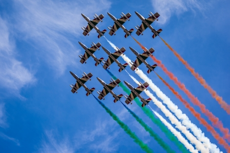 The italian acrobatic jet squad named frecce tricolori doing tricks in the sky photo
