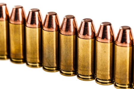 a row of unused 9mm bullets isolated on white photo