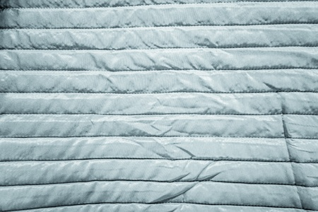 detail of a warm and striped quilt crumpled in some points Stock Photo - 20706089