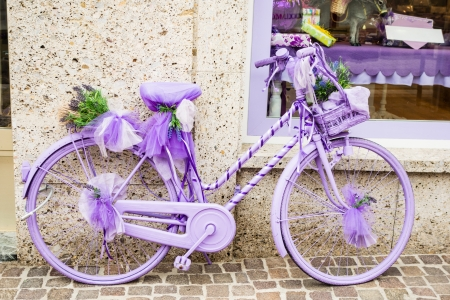 a cheerful and girly lilac bycicle at the street side Stock Photo - 20706127