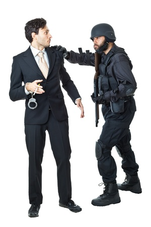 being arrested: a corrupted businessman being arrested by a swat agent