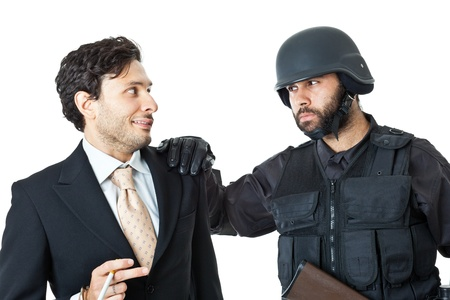 a corrupted businessman being arrested by a swat agent Stock Photo - 20761360
