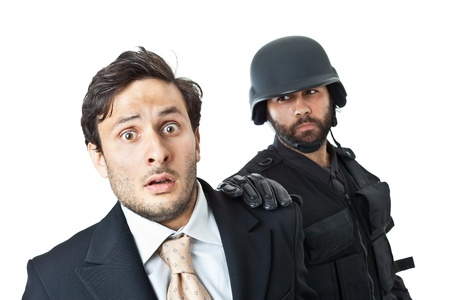 a corrupted businessman being arrested by a swat agent Stock Photo - 20761365