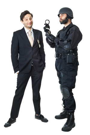 a corrupted businessman being arrested by a swat agent photo