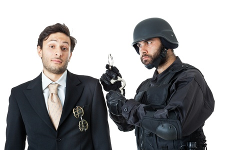busted: a corrupted businessman being arrested by a swat agent