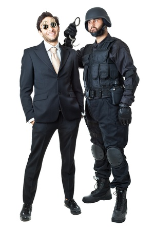 a corrupted businessman being arrested by a swat agent Stock Photo - 20761373
