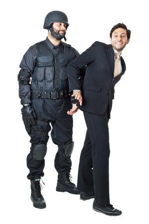 a corrupted businessman being arrested by a swat agent Stock Photo - 20761376