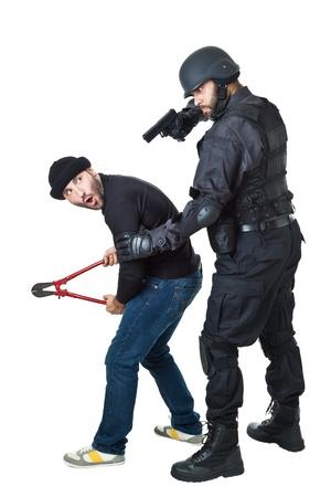 Ein verängstigter Einbrecher von einem SWAT oder Polizisten gesprengt Standard-Bild - 20761384