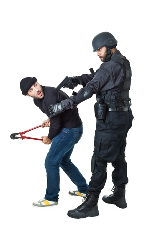 a scared burglar busted by a swat or police officer
