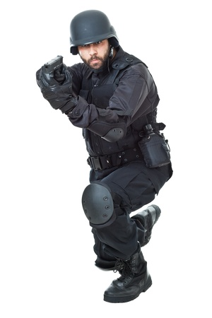 kevlar: a swat agent wearing a bulletproof vest and aiming with a gun