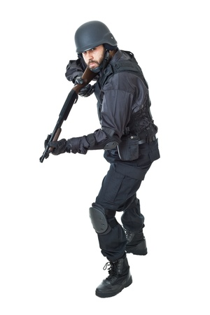 a swat agent wearing a bulletproof vest and aiming with a gun Stock Photo - 20761389