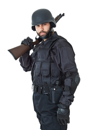 a swat agent wearing a bulletproof vest and aiming with a gun Stock Photo - 20761392