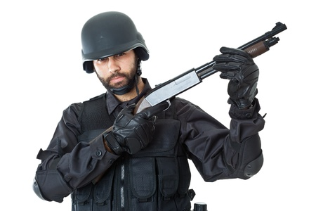 a swat agent wearing a bulletproof vest and aiming with a gun Stock Photo - 20761395
