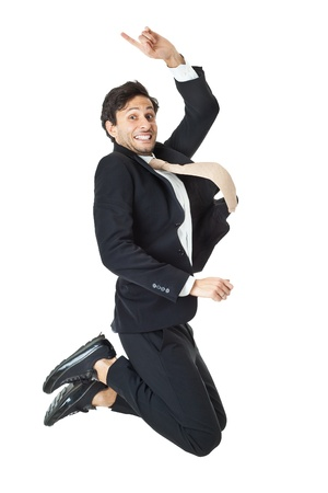 an handsome businessman jumping on a white background Stockfoto