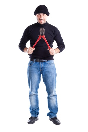 trepassing: a burglar or a thief holding big wire cutters