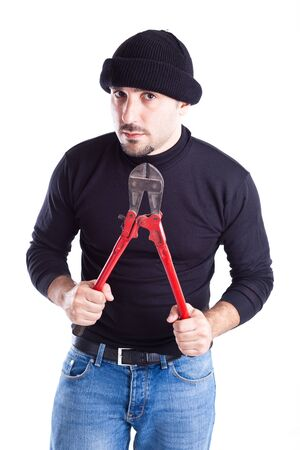 a burglar or a thief holding big wire cutters Stock Photo - 20926963