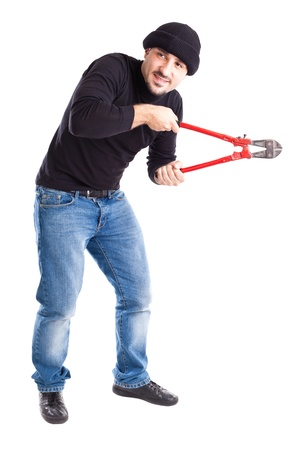wire cutters: a burglar or a thief holding big wire cutters